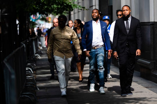 Rapper Meek Mill departs from the criminal justice center in Philadelphia after a status hearing on Aug. 6, 2019. A decision on whether Mill will be retried in a drug and gun case has been delayed until later this month.