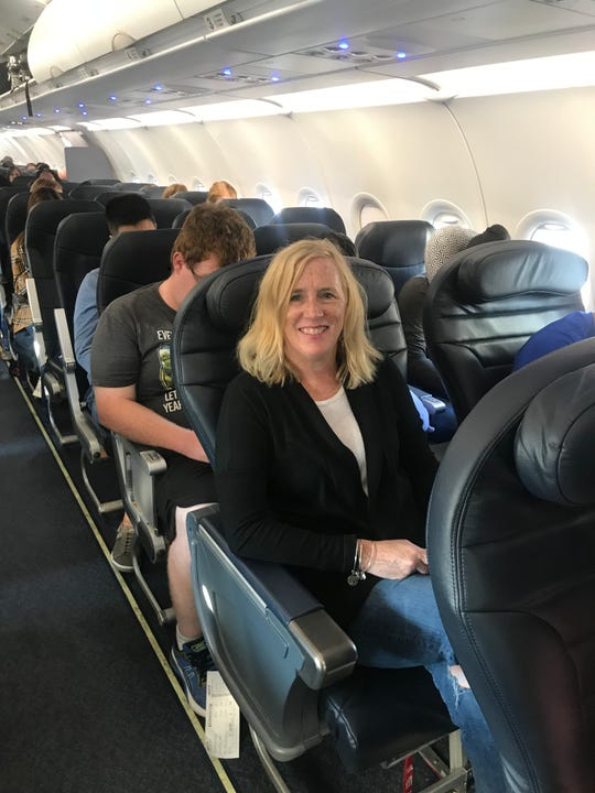 USA TODAY travel reporter Dawn Gilbertson in one of Spirit Airlines' roomy Big Front Seats on a flight from Dallas to New York. The fee to reserve the extra legroom seat at the front of the plane: $60.