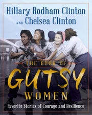 """This undated photo provided by Simon & Schuster shows the book cover of """"The Book of Gutsy Women,"""" by Hillary Clinton and Chelsea Clinton. The book is due out Oct. 1, 2019."""
