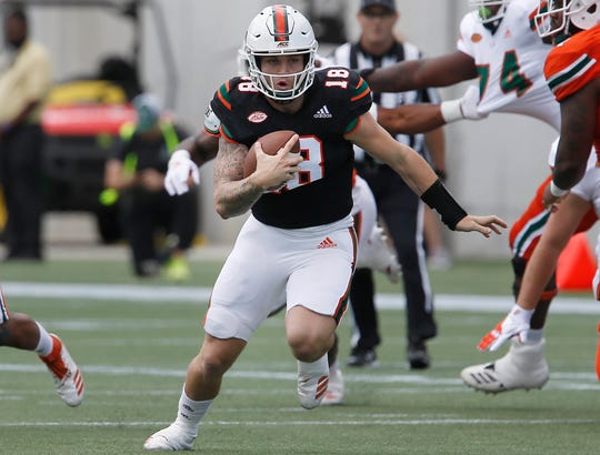 Miami (Fla.) quarterback Tate Martell runs the team's spring game in April of 2019.