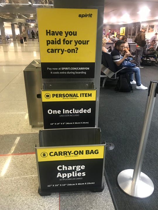 A Spirit Airlines bag sizer in the gate area at Chicago O'Hare International Airport.