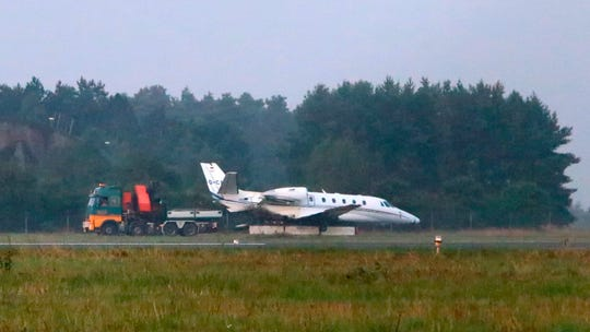 The plane's right side appeared less damaged in the light of day Tuesday.