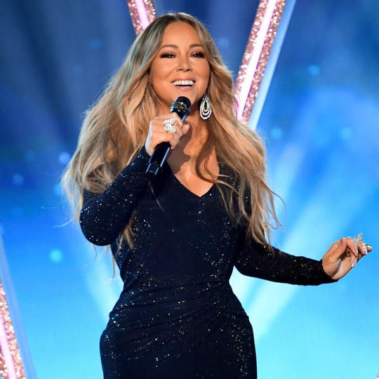Mariah Carey posted cheeky tweets about meeting the Clintons, which showed her political leanings.