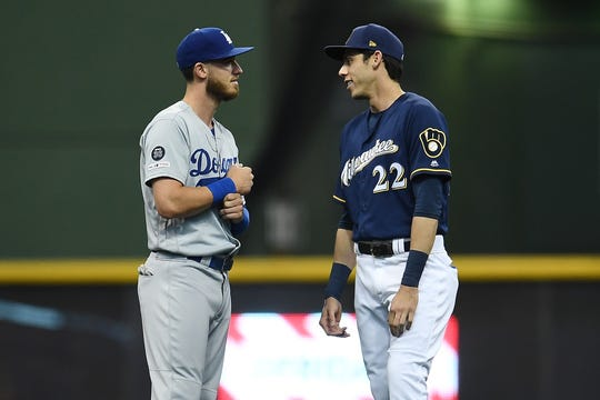 Bellinger and Yelich chat before a game in April.