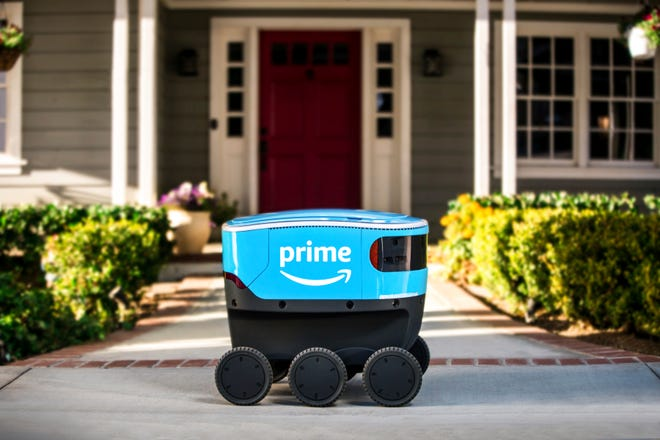 This undated photo provided by Amazon shows a self-driving delivery robot that Amazon is calling Scout.  Amazon is expanding the use of its self-driving delivery robots to a second state.