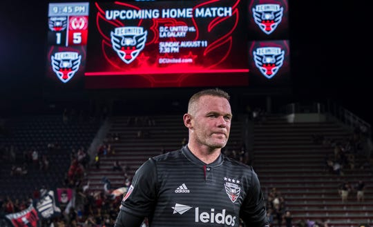 Wayne Rooney walks off the field follow a 5-1 loss to the Philadelphia Union on Sunday.