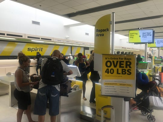 Spirit Airlines' weight limit on checked bags is 40 pounds, versus 50 pounds at most competitors. The airline has set up a repack area so passengers can take stuff out of their bags to avoid overweight bag fees.
