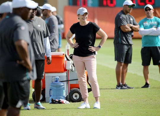 Jill Ellis, who led the U.S. Women's National Team to historic back-to-back FIFA Women's World Cup titles, visits the Miami Dolphins  NFL football training camp, Tuesday, Aug. 6, 2019 in Davie, Fla.