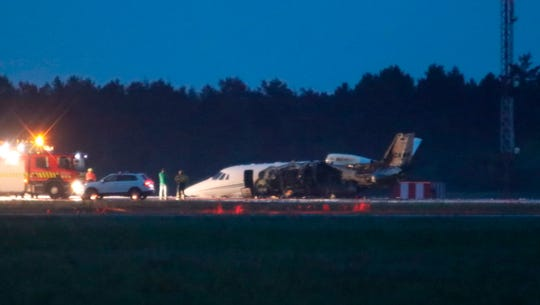 The fuselage of the Cessna carrying members of Pink's management team from Norway to Denmark caught fire during a crash-landing at Aarhus Airport in Tirstrup, Denmark late Monday night. The plane's left side appeared to suffer the most damage.