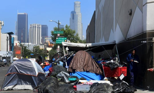 Belongings of the homeless crowd a downtown Los Angeles sidewalk in Skid Row on May 30, 2019.
