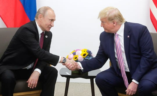 Russian President Vladimir Putin shakes hands with President Donald Trump during their meeting at the G20 summit in Osaka, Japan on June 28, 2019.