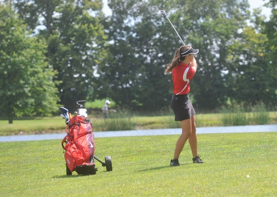 Buckeye Central's Megan Rhodes hits from the fairway of the fifth hole at Cranberry Hills.
