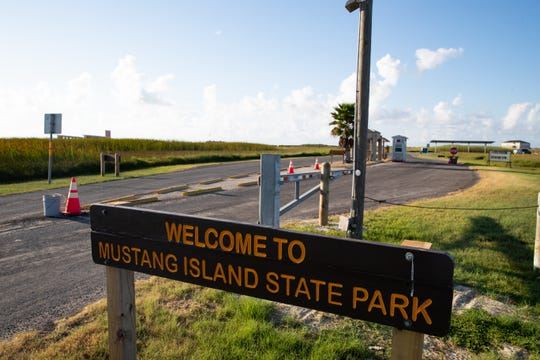 The entrance sign and temporary fee booth at Mustang Island State Park Friday, Aug. 2, 2019. The original fee booth was destroyed by flooding during Hurricane Harvey in 2017.