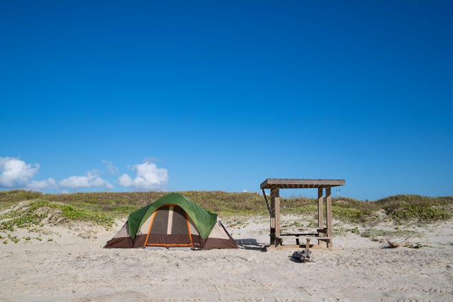 A tent setup long the beach at Mustang Island State Park on Friday, Aug. 2, 2019. The park offers primitive camping along the beach or RV sites with water and electric hookups.