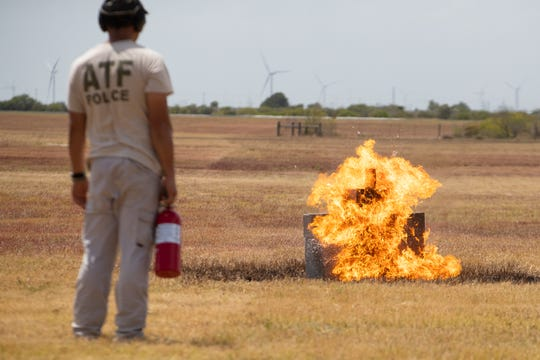 A Molotov cocktail is thrown as the Bureau of Alcohol, Tobacco, Firearms and Explosives along with members of local police departments conduct an explosives demonstration during a training class at the McCampbell-Porter Airport on Wednesday, Aug. 7, 2019