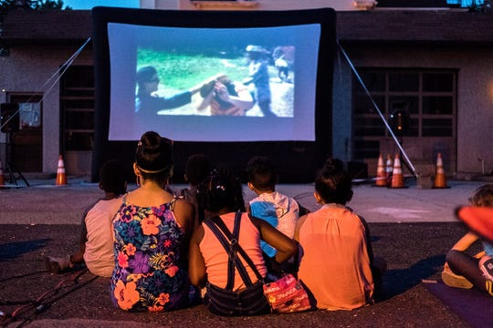 Collingswood Night Market visitors take in an outdoor film next to Grooveground last year.