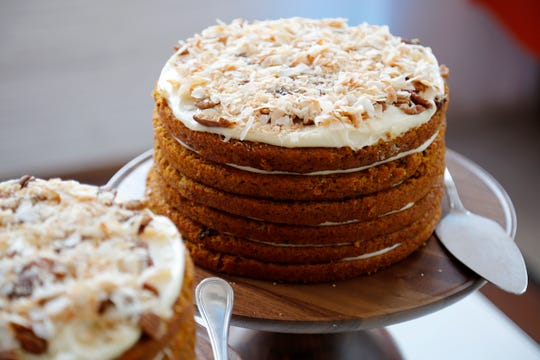 A six-layer carrot cake at the Streitmann Center in the Over-the-Rhine neighborhood of Cincinnati on Wednesday, Aug. 7, 2019. FC Cincinnati played host to a preview of some of the food options expected to be available in the team's future West End stadium.