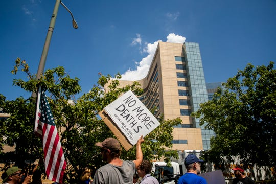 Protestors gather outside Miami Valley Hospital in Dayton, Ohio Wednesday, August 7, 2019 where President Donald Trump is visiting victims and police officers involved in the Sunday morning shooting.