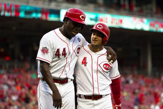 Cincinnati Reds shortstop Jose Iglesias (4) celebrates with Cincinnati Reds right fielder Aristides Aquino (44) after hitting a 2-run home run in the first inning of the MLB baseball game between Cincinnati Reds and Los Angeles Angels on Tuesday, Aug. 6, 2019, at Great American Ballpark in Cincinnati.