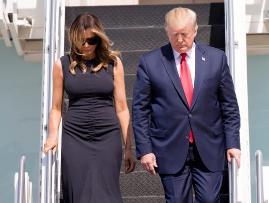 President Donald Trump and First Lady Melania Trump step off Air Force One at Wright-Patterson Air Force Base, Wednesday, Aug. 7, 2019, to visit Dayton, Ohio, following the mass shooting that left nine dead and 27 injured early Sunday morning.