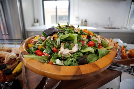 A large salad is displayed at the Streitmann Center in the Over-the-Rhine neighborhood of Cincinnati on Wednesday, Aug. 7, 2019. The MLS team hosted an event to preview some of the elevated food options expected to be available in the team's future West End stadium.