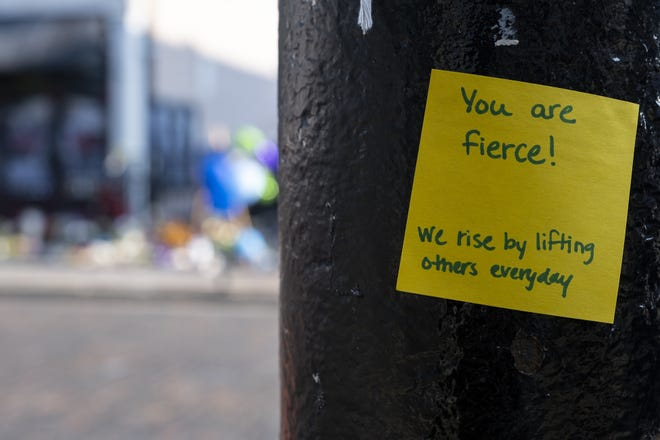 Post-it notes are placed throughout the Oregon District of Dayton, Ohio, on Wednesday, Aug. 7, 2019.