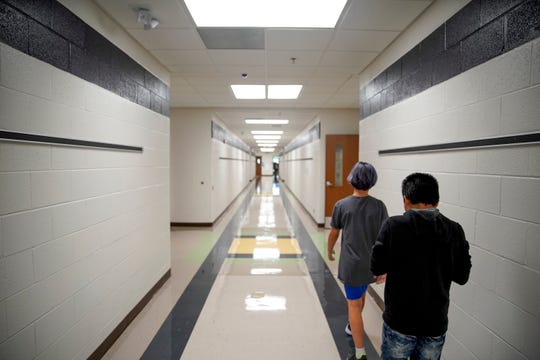 Students walk down the long hallways on the first day of class at Minglewood Elementary School in Clarksville, Tenn., on Wednesday, Aug. 7, 2019.