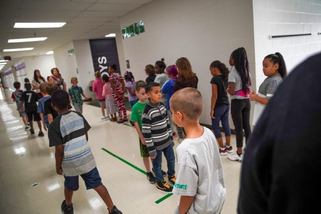 Students line up and follow an organized system during bathroom breaks on the first day of class at Minglewood Elementary School in Clarksville, Tenn., on Wednesday, Aug. 7, 2019.