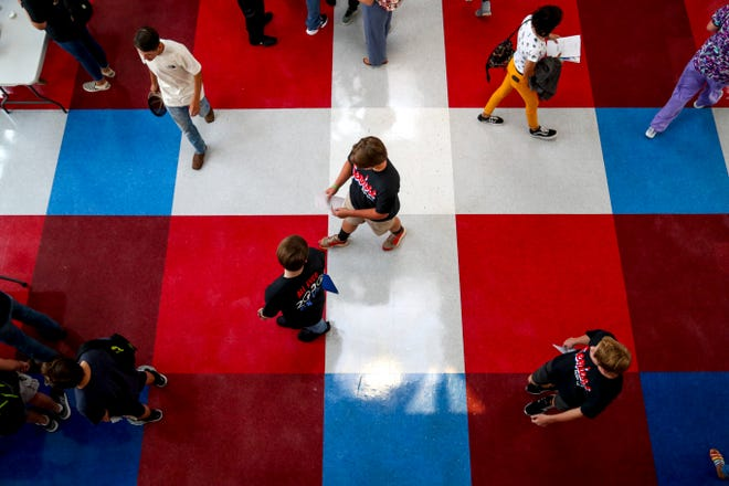 Students walk about and compare schedules to see what classes they have together on the first day of school at Montgomery Central High School in Cunningham, Tenn., on Wednesday, Aug. 7, 2019.