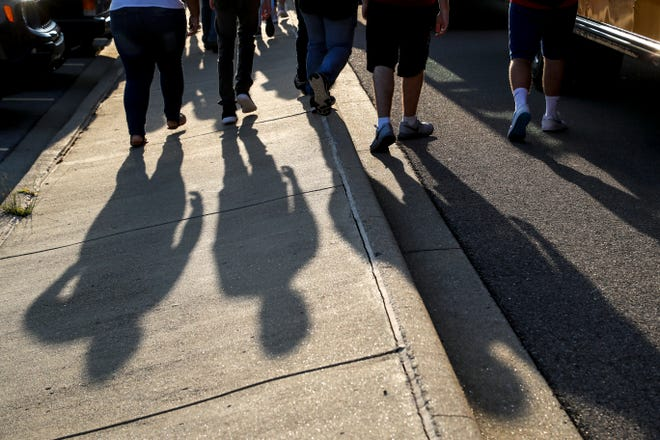 Students walk from the buses to school on the first day of classes at Montgomery Central High School in Cunningham, Tenn., on Aug. 7, 2019.