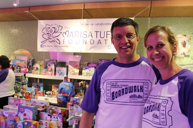 Greg Tufaro and his wife, Cyndi, founded the Marisa Tufaro Foundation following the passing of their daughter, Marisa, on January 30, 2017. The mission of the Foundation is to help children in need throughout the greater Middlesex County area. Greg and Cyndi are pictured here in front of the prize table at the 2nd Annual Family Fun Night hosted by the Marisa Tufaro Foundation at PSE&G Children's Specialized Hospital in New Brunswick.