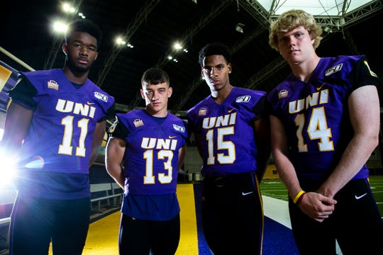 Northern Iowa quarterbacks Justin Fomby (11) Will McElvain (13) Jacob Keller (15) and Nate Martens (14) pose for a photo during the Panthers football media day, Wednesday, Aug. 7, 2019, at the UNI-Dome in Cedar Falls, Iowa.