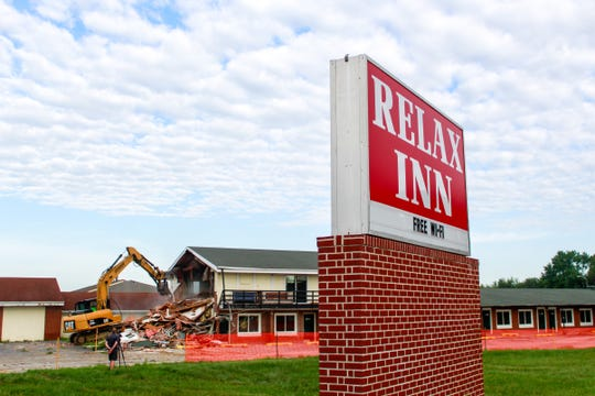 Des Moines crew tear down the Relax Inn, 4144 Hubbell Ave., on Wednesday morning, Aug. 7, 2019, on the city's northeast side. The city will build Fire Station 11 on the site.