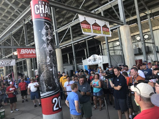 Fans look on Wednesday evening as sprint car driver Brad Sweet (blue T-shirt) speaks with reporters at Knoxville Raceway.