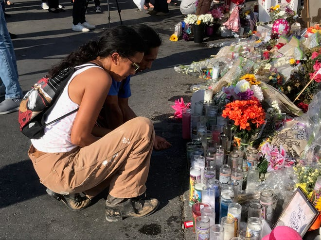 Hundreds of mourners gathered Tuesday, Aug. 6, at a memorial site outside the El Paso Walmart, where 22 people were killed in a mass shooting on Saturday, Aug. 3, 2019.