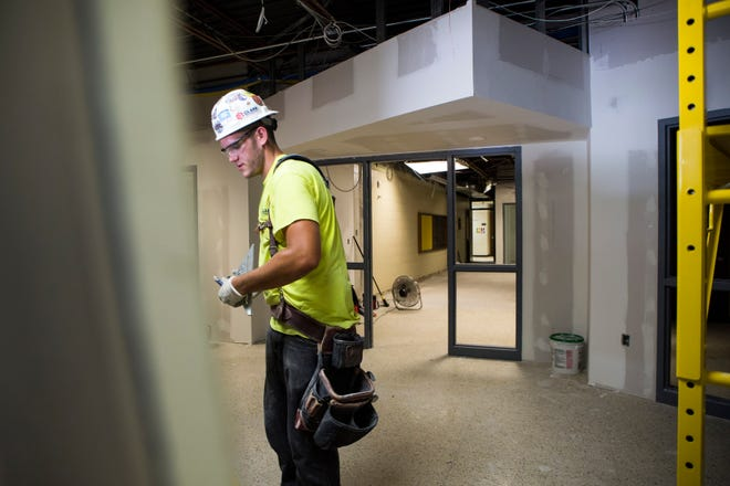 In response to mass shooting threats, carpenter Connor Spencer works on the install of security upgrades like new security doors and a vestibule to make it harder for intruders to enter at Hunter Elementary School in Brownstown Twp., Mich., Wednesday, Aug 7, 2019.