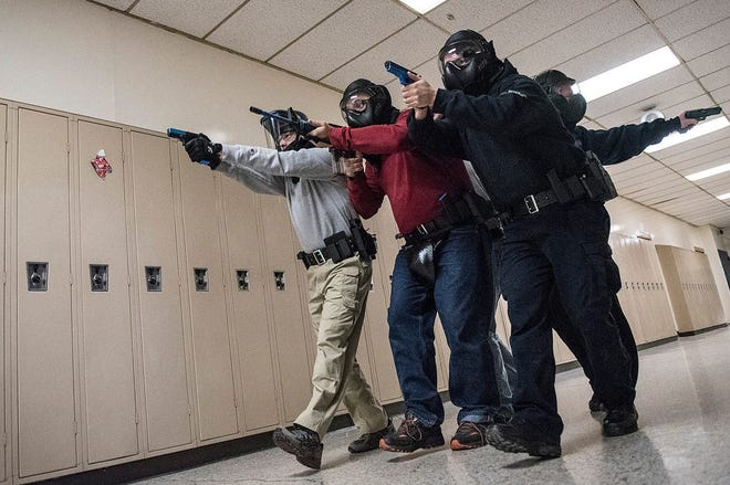 Plymouth Township police officers participate in a simulated active shooter during training at the Plymouth Arts and Recreation Complex  in January 2017.