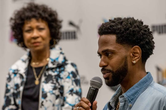 Myra Anderson looks on as her son, rapper Big Sean, speaks during a DON Weekend event at the Charles Wright museum on June 22, 2018.
