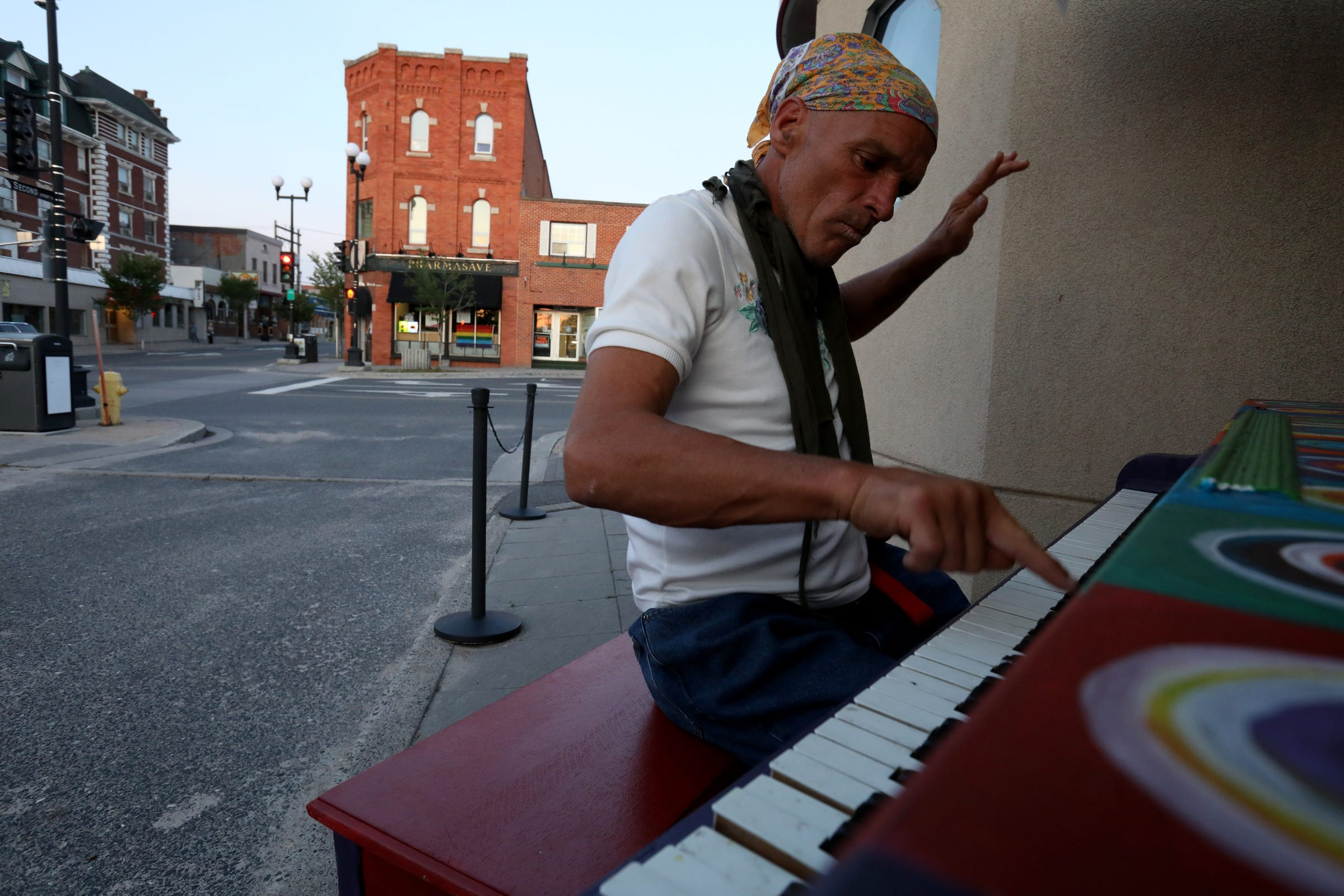 Out and about at dusk on Wednesday, July 10, 2019 in Kenora, Ontario, Canada, Joe Murphy plays piano at one of the few piano art installations around the town.After living in a hotel in Kenora, Ontario, Canada set up by former NHL hockey players, former Detroit Red Wings player Joe Murphy is back on the streets of that city and homeless. Murphy still wanders the town sleeping out in the open in different places, getting food and clothing from the Fellowship Centre that helps the homeless population in Kenora.