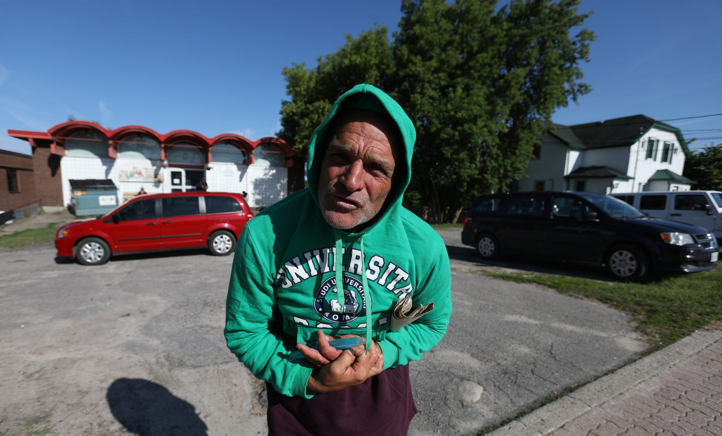 Coming out of the Fellowship Centre, a place for the homeless to get food, shelter, clothes and a shower, Joe Murphy starts talking to Detroit Free Press photojournalist Eric Seals about spirits and UFO's before he left to wander around the town of Kenora, Ontario, Canada on Thursday morning, July 10, 2019.After living in a hotel in Kenora, Ontario, Canada set up by former NHL hockey players, former Detroit Red Wings player Joe Murphy is back on the streets of that city and homeless.