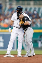Detroit Tigers designated hitter Miguel Cabrera (24) and Chicago White Sox second baseman Yolmer Sanchez (5) hug during the third inning at Comerica Park on August 06, 2019 in Detroit, Michigan.