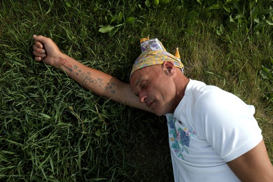 Joe Murphy sleeps underneath the Canadian Tire gas station sign that many residents of Kenora, Ontario, Canada are use to seeing him at.