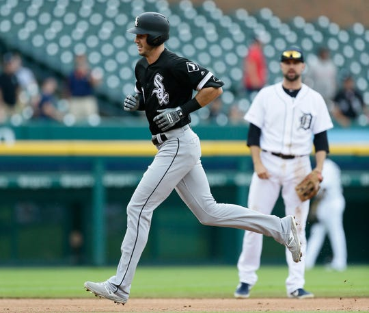 White Sox center fielder Ryan Cordell rounds the bases past Tigers shortstop Jordy Mercer after hitting a solo home run during the second inning on Wednesday, Aug. 7, 2019, at Comerica Park.