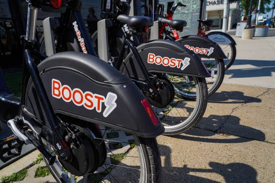 MoGo Boost bikes are displayed in a station at Eastern Market in Detroit on Monday, August 5, 2019.