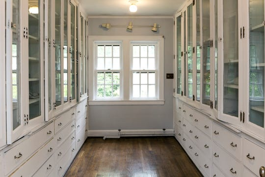 The second floor has a 16-foot-deep walk-in linen room with glass fronts on all doors and more than 100 shelves.