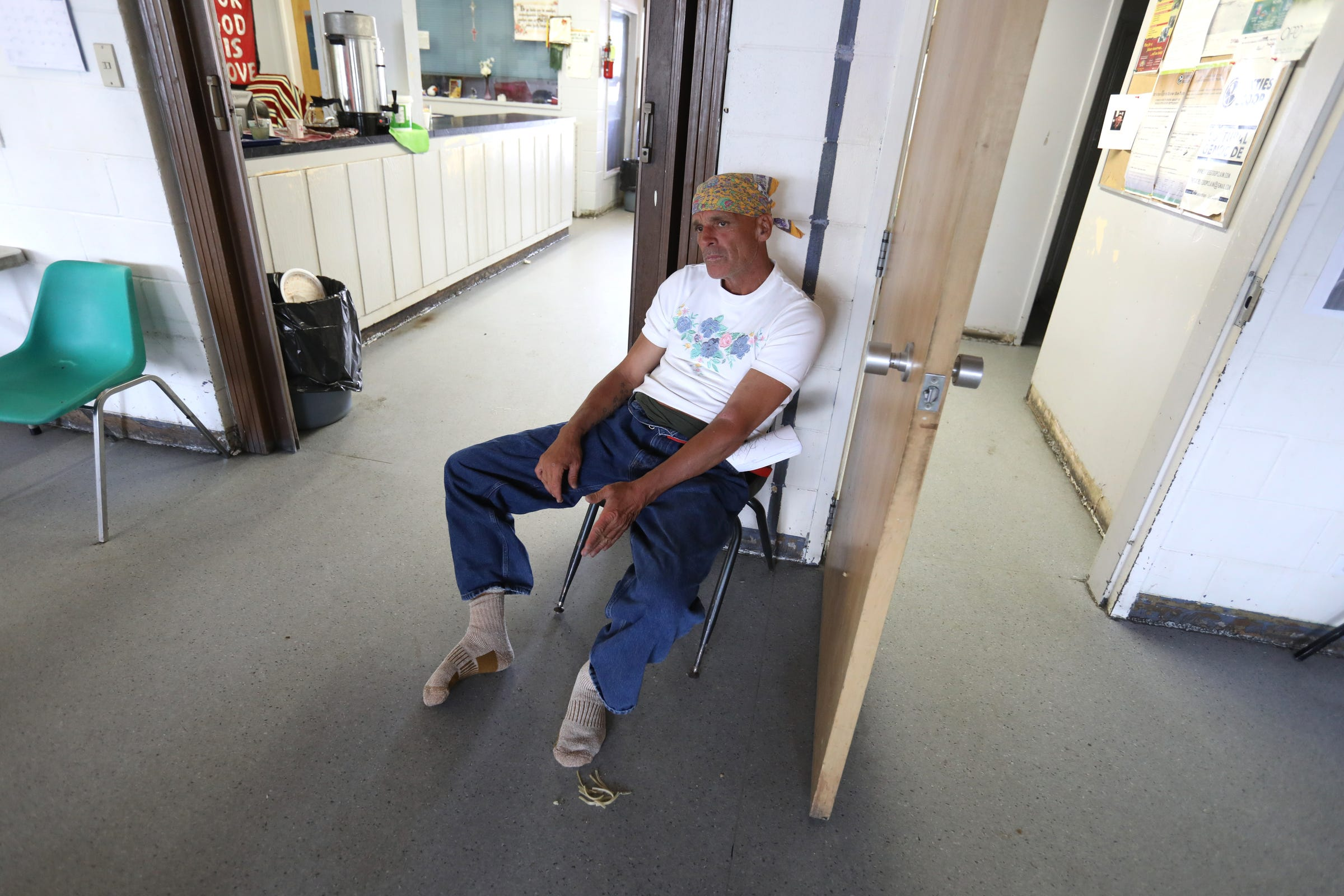 With a new shirt, jeans and socks but no shoes since they are waterlogged from the rain, Joe Murphy relaxes at the Fellowship Centre in Kenora, Ontario, Canada on Wednesday, July 10, 2019 Living on the streets Murphy relies on the center often for food, coffee, clothing and showers.After living in a hotel in Kenora, Ontario, Canada set up by former NHL hockey players, former Detroit Red Wings player Joe Murphy is back on the streets of that city and homeless.