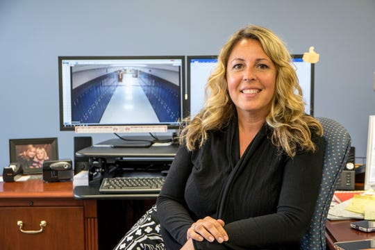 Gibraltar Public Schools Superintendent Amy Conway has access to live security camera video throughout the district at her office in Woodhaven, Mich., Wednesday, Aug 7, 2019.
