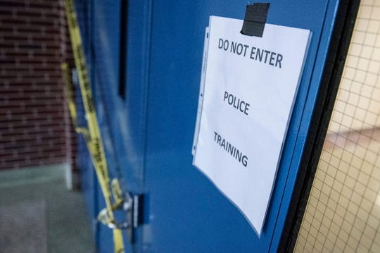 A sign warns of a simulated active shooter during training for Plymouth Township police at the Plymouth Arts and Recreation Complex in January 2017.