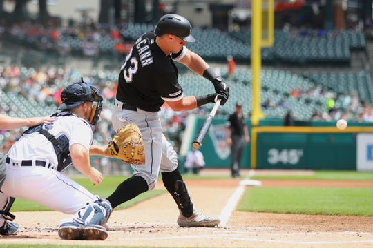 White Sox catcher James McCann hits a RBI single in front of Tigers catcher Jake Rogers in the first inning on Wednesday, Aug. 7, 2019, at Comerica Park.