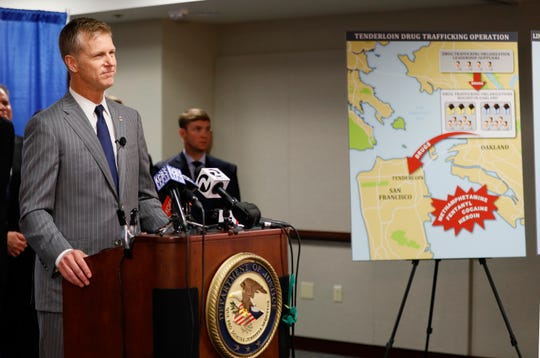 U.S. Attorney David Anderson announces a new federal crime-fighting initiative in San Francisco on Wednesday, Aug. 7, 2019. Seventeen federal law enforcement agencies will team up for a yearlong crackdown on a notorious area of San Francisco where open drug use has been tolerated for years.